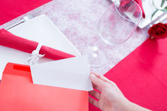 Woman getting paper sheet from envelope Royalty Free Stock Photos