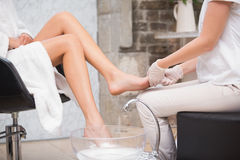 Woman getting a pedicure from beautician Royalty Free Stock Photos