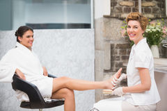 Woman getting a pedicure from beautician Royalty Free Stock Images