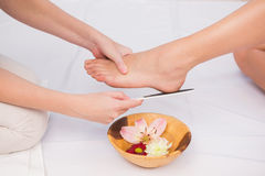 Woman getting a pedicure from beautician Royalty Free Stock Image
