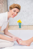 Woman getting a pedicure from beautician Stock Image