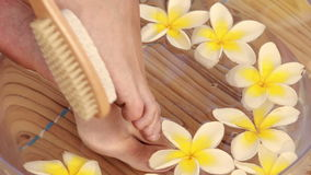 Woman getting pedicure at nail salon stock video