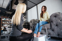Woman getting a pedicure and relaxing at the beauty salon Stock Photo