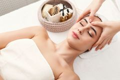 Woman getting professional facial massage at spa. Facial massage. Spa, resort, beauty and health concept. Beautiful woman getting professional face treatment stock photos