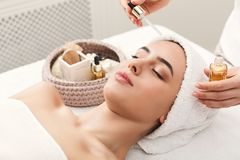 Woman getting professional facial massage at spa. Facial massage. Spa, resort, beauty and health concept. Beautiful woman getting professional face treatment stock image