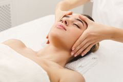 Woman getting professional facial massage at spa salon. Facial massage. Spa, resort, beauty and health concept. Beautiful woman getting professional face royalty free stock image