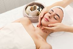 Woman getting professional facial massage at spa salon. Facial massage. Spa, resort, beauty and health concept. Beautiful woman getting professional face royalty free stock images