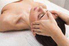 Woman getting professional facial massage at spa salon. Facial massage. Spa, resort, beauty and health concept. Beautiful woman getting professional face stock photography