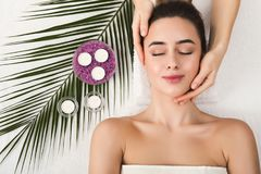 Woman getting professional facial massage at spa salon. Facial massage. Spa, resort, beauty and health concept. Beautiful woman getting professional face royalty free stock photos