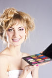 Woman getting professional make up Stock Photography