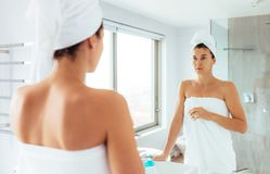 Woman getting ready after bath Stock Image