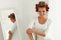 Woman Getting Ready. Beautiful Model With Hair Rollers On Hair. Woman Getting Ready. Beautiful Happy Female Model With Hair Rollers On Healthy Blonde Hair Royalty Free Stock Photography