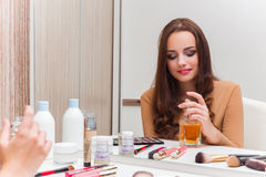 The woman getting ready for the party Stock Photography