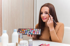 The woman getting ready for the party Stock Photos