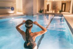 Free Woman Getting Ready To Swim In Indoor Swimming Pool At Hotel Or Apartment Building Complex - Condo Amenities Royalty Free Stock Image - 181196776