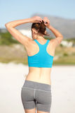 Woman getting ready for workout at the beach Stock Photos