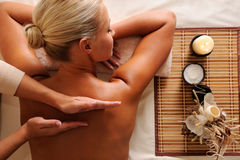 Woman getting recreation massage. In spa salon - high angle royalty free stock photos