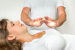 Woman getting reiki healing therapy - alternative medicine. Young woman getting reiki healing therapy - alternative medicine concept stock photo