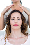 Woman getting reiki therapy Stock Photography