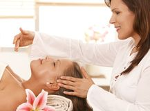 Woman getting relaxing head massage Stock Photo