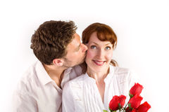 Woman getting roses from man Stock Photo