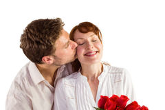 Woman getting roses from man Stock Image