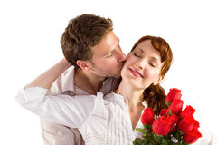 Woman getting roses from man Stock Photography