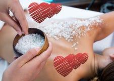 Woman getting sea salt massage on back Royalty Free Stock Photography