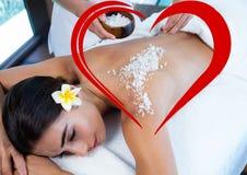 Woman getting sea salt massage on back Stock Photography