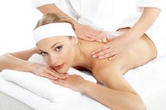 Woman Getting Shoulder Massage from Masseuse Stock Images