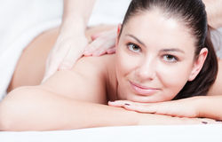 Woman getting shoulder massage at spa Stock Image