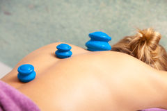 Woman getting spa cupping vacuum massage stock images