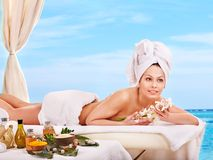 Woman getting spa lastone therapy outdoor. Stock Image