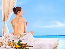 Woman getting spa lastone therapy outdoor. Stock Images