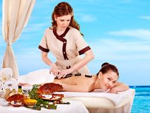 Woman getting spa lastone therapy outdoor. Stock Photos