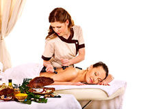 Woman getting spa lastone therapy outdoor. Royalty Free Stock Photo