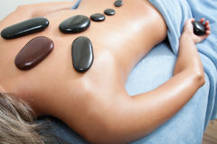 Woman getting spa massage Stock Image