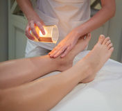 Woman getting spa massage with massage candle Royalty Free Stock Photo