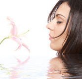 Woman getting spa treatment. Relaxing on water royalty free stock images