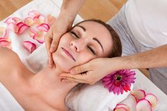 Woman getting spa treatment Stock Photos