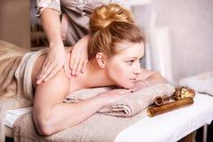 Woman Getting Spa Treatment. Head Massage. Closeup of a Young Woman Getting Spa Treatment stock photos