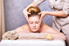 Woman Getting Spa Treatment. Head Massage. Closeup of a Young Woman Getting Spa Treatment Royalty Free Stock Photo