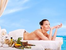 Woman getting spa treatment outdoor. Royalty Free Stock Photography