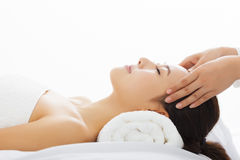 Woman getting spa treatment over white background Royalty Free Stock Image