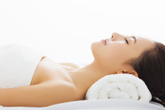 woman getting spa treatment over white background Royalty Free Stock Photography