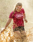 Woman getting splashed by the mud mines Stock Images