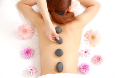 Woman getting stone therapy Stock Photos