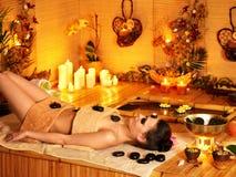 Woman getting stone therapy massage . Stock Photo