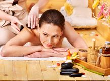 Woman getting stone therapy massage . Stock Image