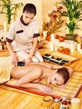Woman getting stone therapy massage . Royalty Free Stock Photography
